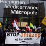 Hundreds protest Amazon expansion in France