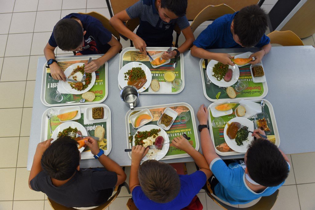 French farmers stage protest over city's decision to make school meals vegetarian