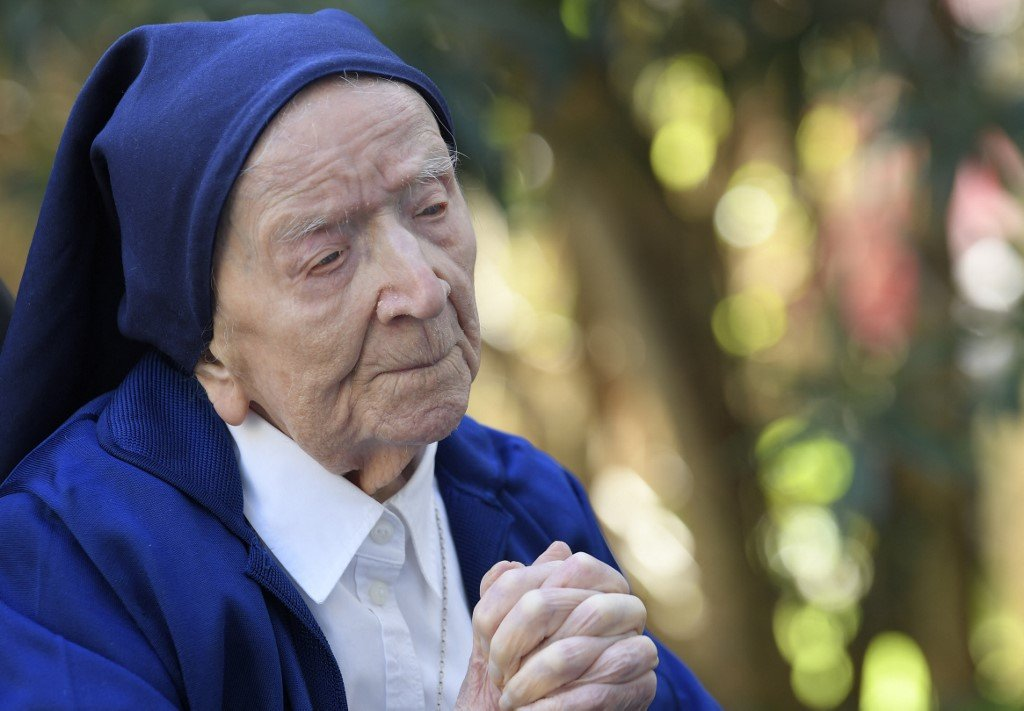 'A glass of wine a day': French nun turns 117 after surviving Covid