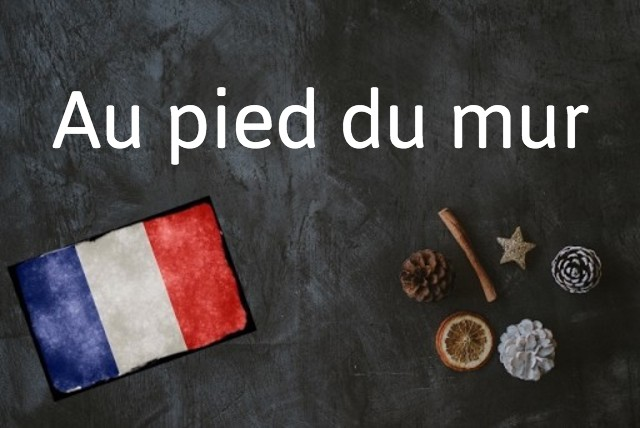 French expression of the day: Au pied du mur