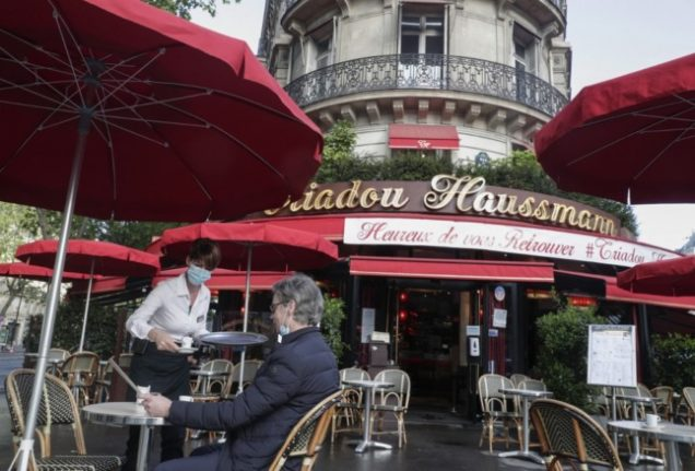 IN PICTURES: The French (and their politicians) head back to café terraces