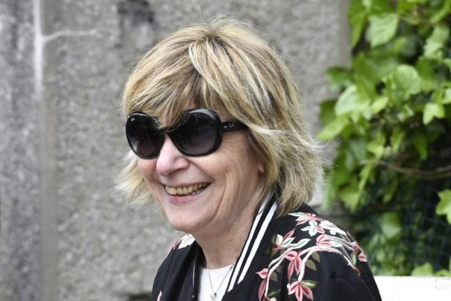 French 'paparazzi queen' charged in Sarkozy probe
