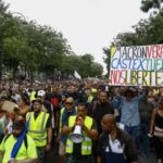 Tens of thousands protest against Macron's health pass in France