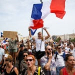French lawmakers seek deal on vaccine passports after protests