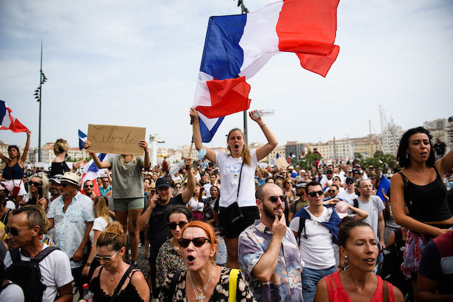 French parliament set to adopt vaccine passports law after protests - The  Local