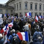 UPDATE: Protesters mass in France against Macron's Covid health pass