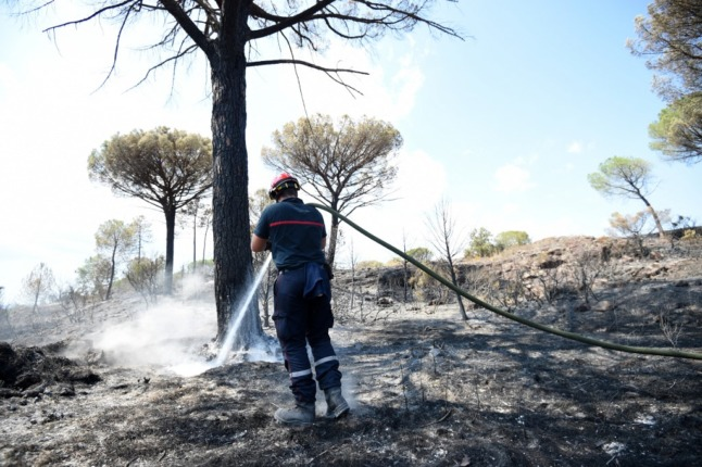 French Riviera wildfire 'no longer spreading but still not under control'