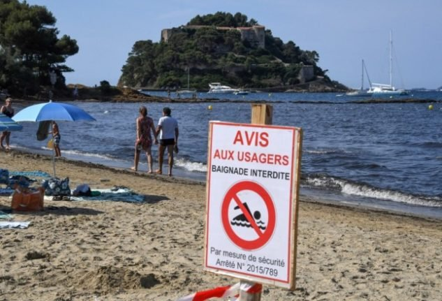 French police launch investigation into photo of Macron in swimming trunks